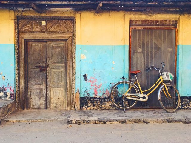 Colorful bike set to the backdrop of ancient alleyways in Stonetown, Zanzibar
