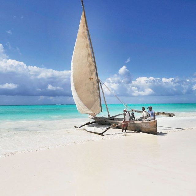 White sandy beach and azure waters in Zanzibar