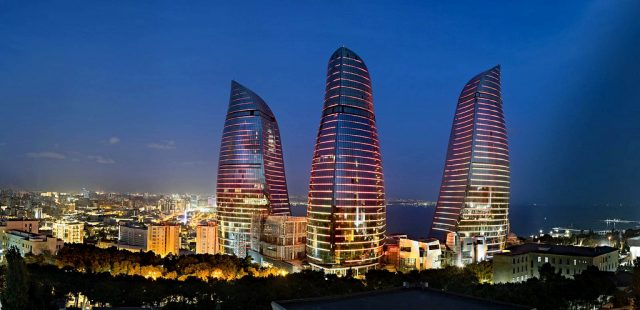 The Flame Towers lit up at night in Baku