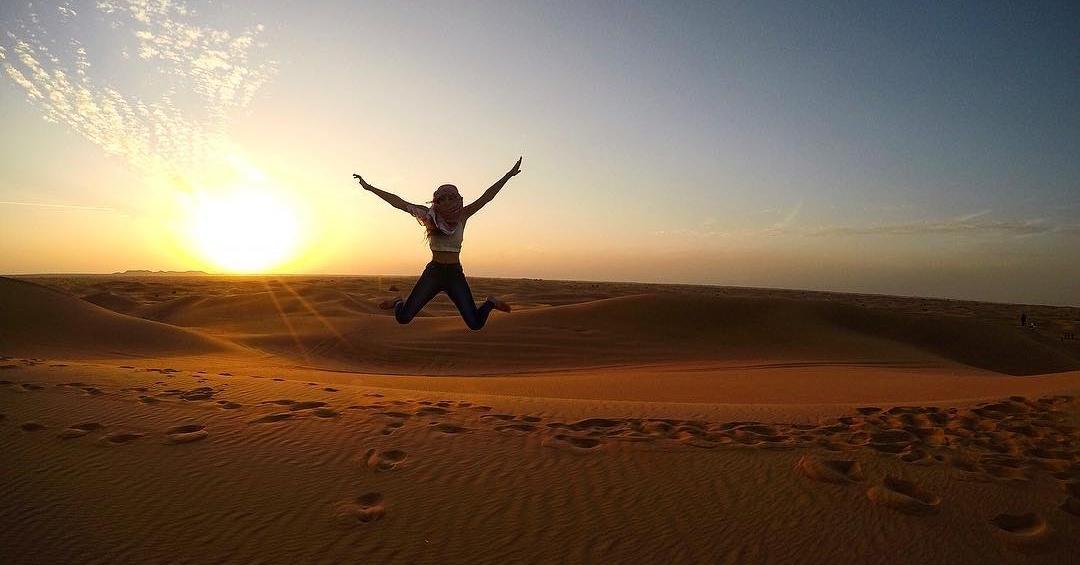 dubai desert safari jumping selfie Cropped