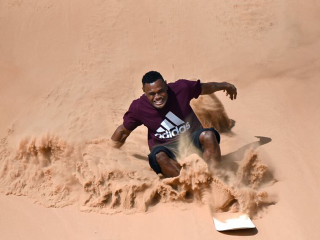 dubai desert safari sand boarding