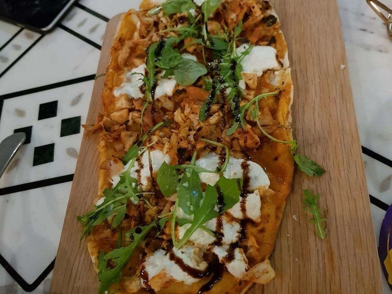 Butter Chicken Pizza at Masti Dubai