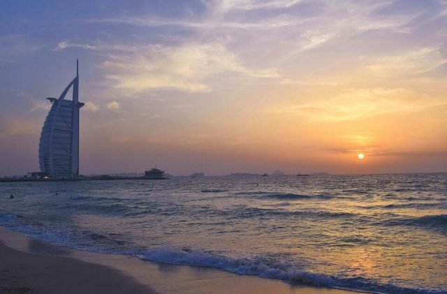 best view of iconic dubai landmarks - burj al arab sunset beach