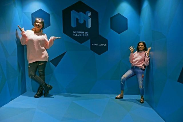 visitors at dubai museum of illusions shrinking