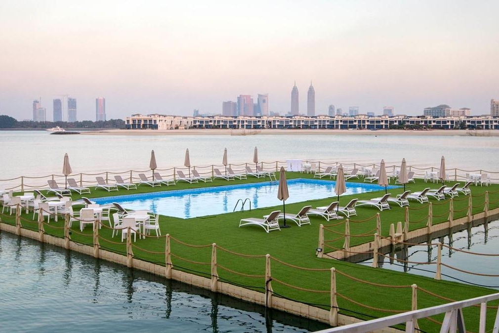 Things-to-do-in-Palm-Jumeirah-Dubai-floating-pool-at-Breeze-Beach-Grill-Cropped