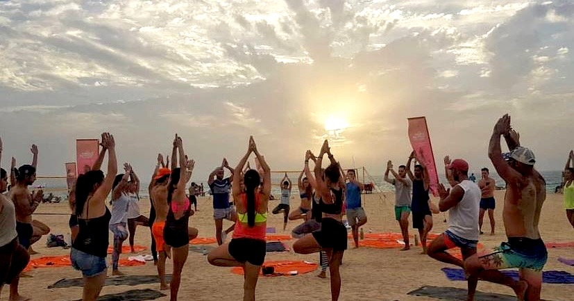 classes in dubai - sunset yoga at kite beach dubai