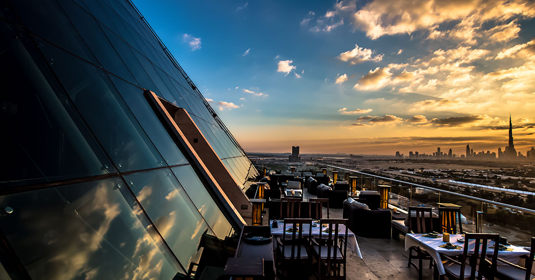 rooftop bars in dubai - happy hour deals - tomo raffles dubai