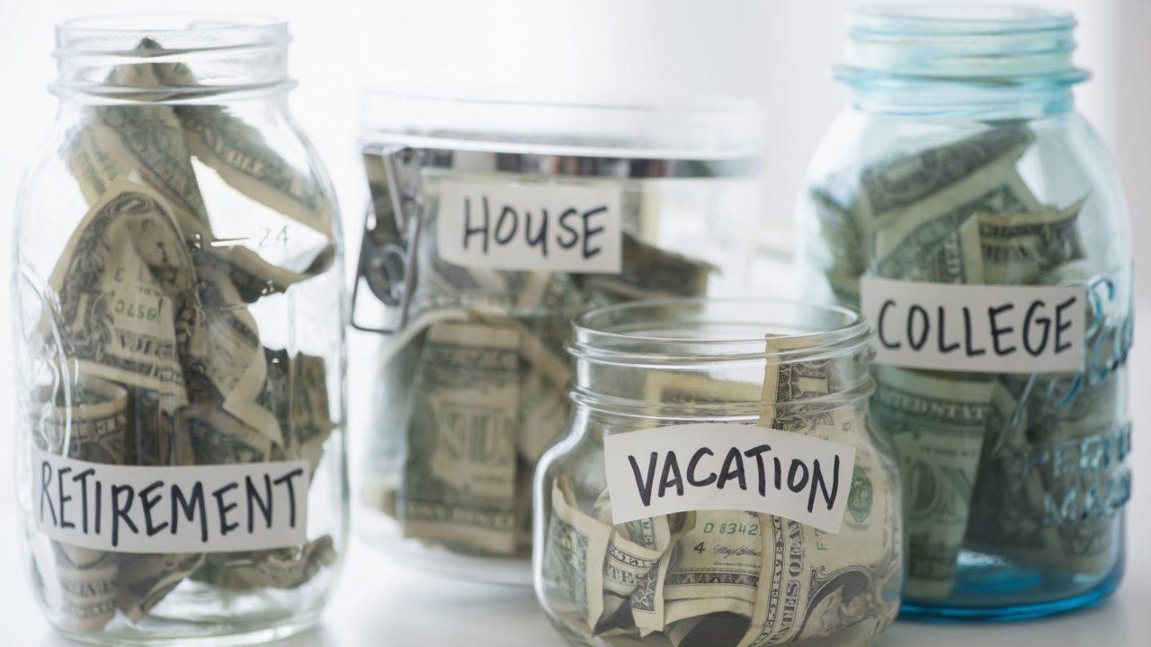 close-up-of-savings-jars-with-money-580502927-5b021d8e1d64040036e93cd8